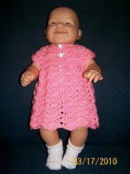 pink baby dress with ripple pattern