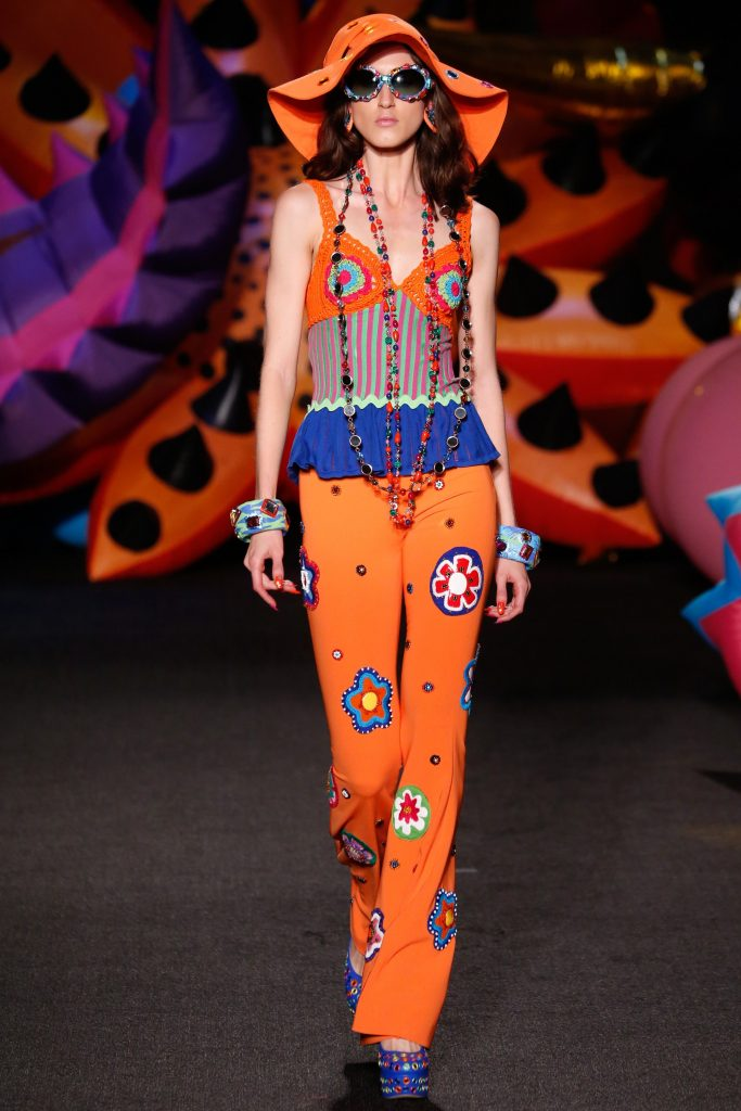 orange pants flowers and necklace