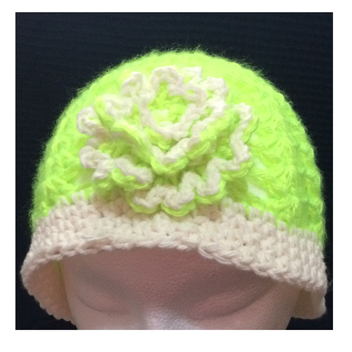 bright green beanie with flower