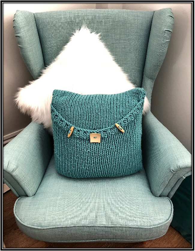 knitted luxury pillow pattern soft teal in Scandinavian chair