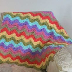 pastel colour blanket on couch
