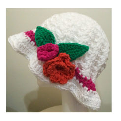 White crochet hat pink stripe and red flowers